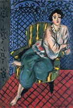Woman sitting in a chair 1920